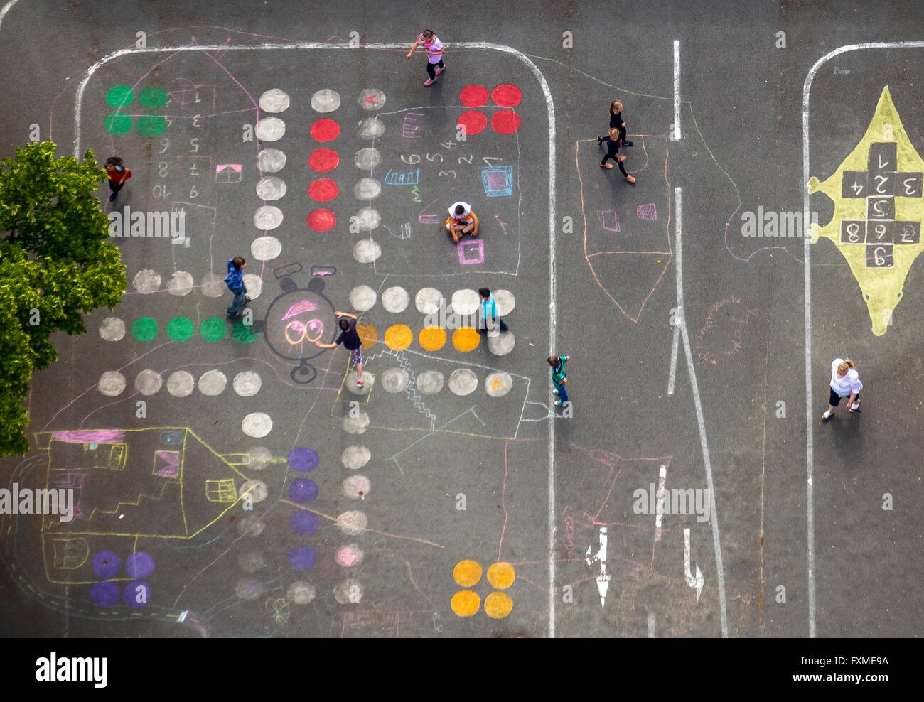 Aerial view, playground of the Theodor-Heuss-Schule, game: 'parchesi you-not' Headache is a board game - Stock Image
