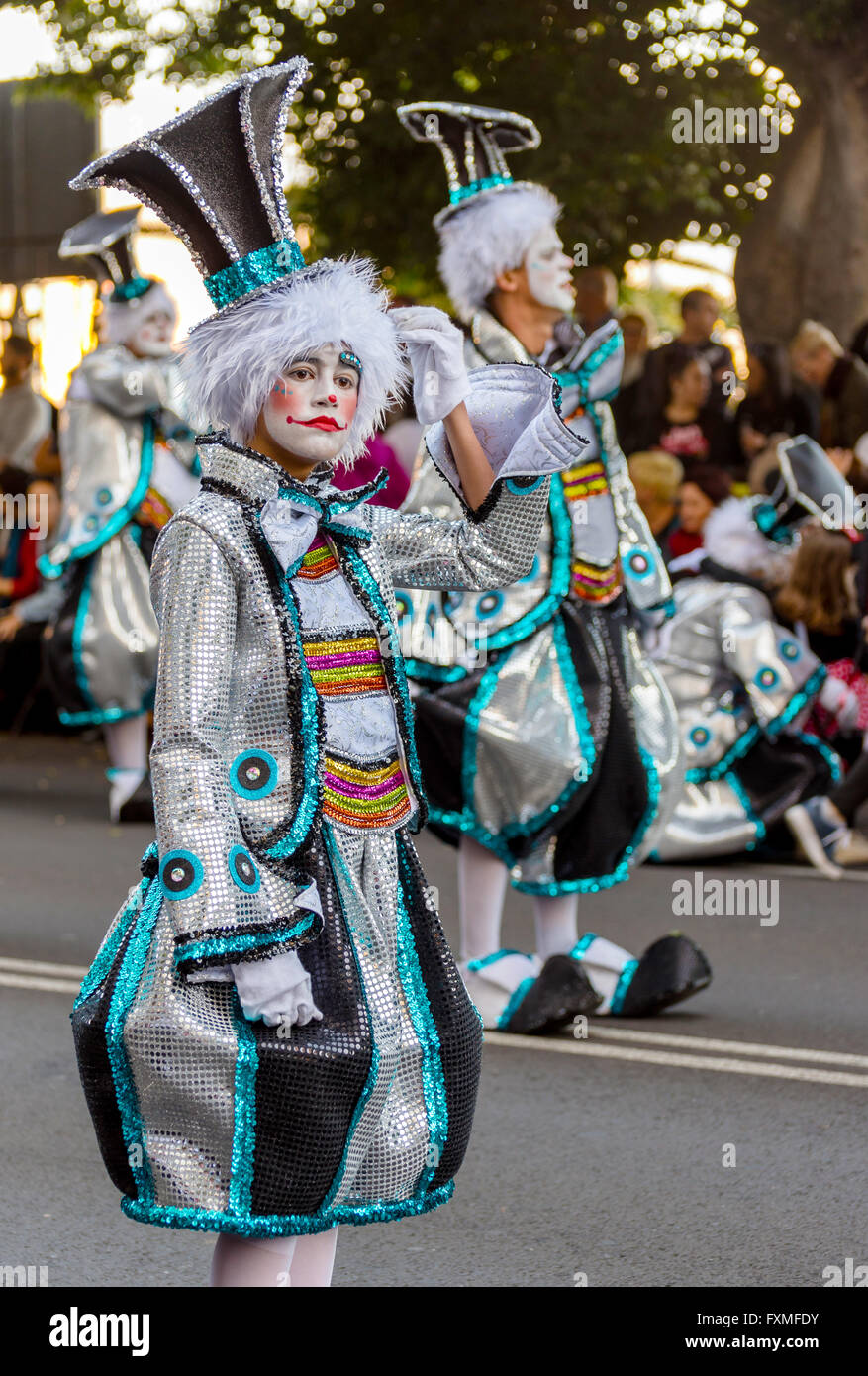 Woman in elaborate clown costume, Carnival Procession, Santa Cruz, Tenerife - Stock Image