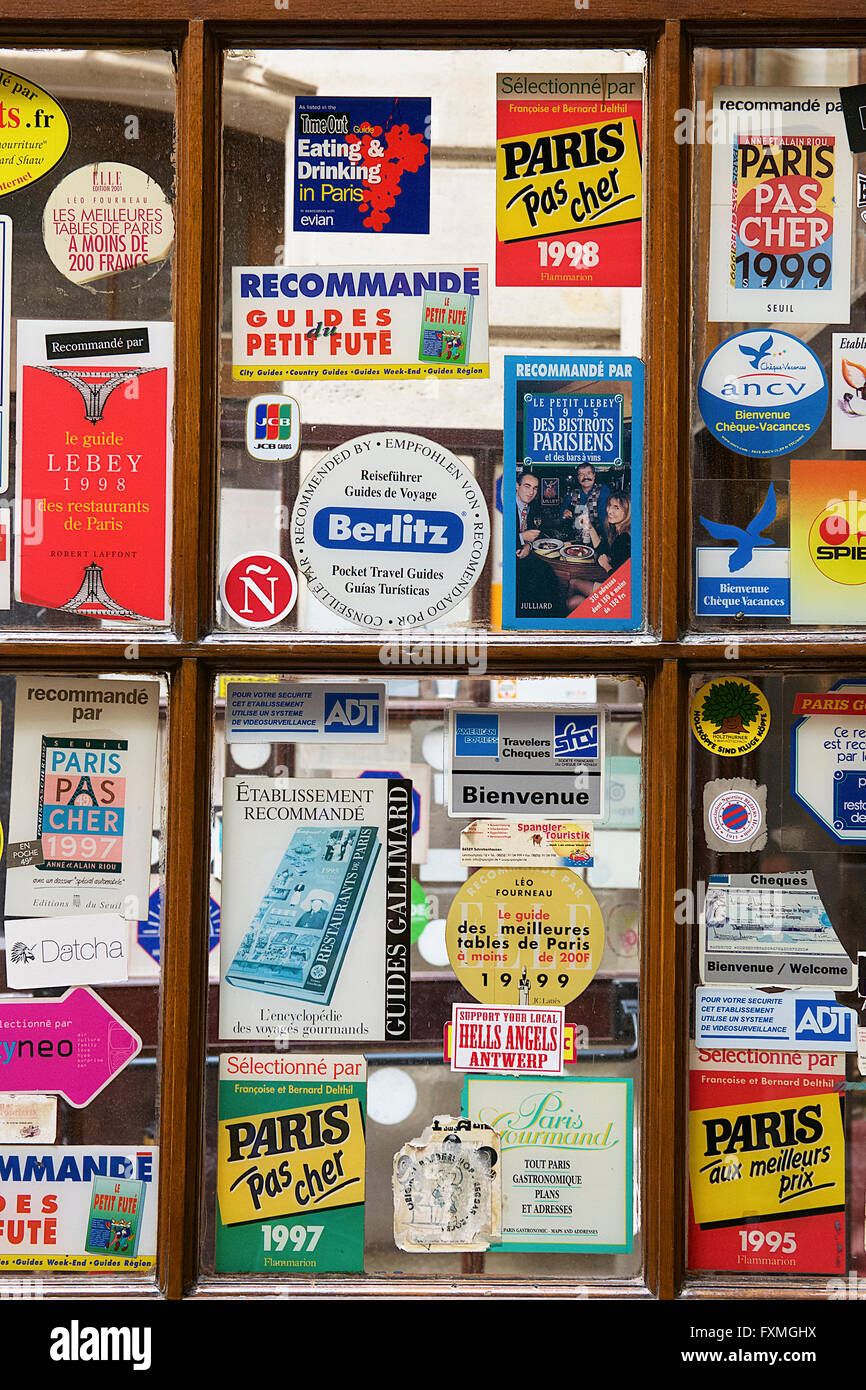 Travel Guides Sticker on Window, Paris, France - Stock Image
