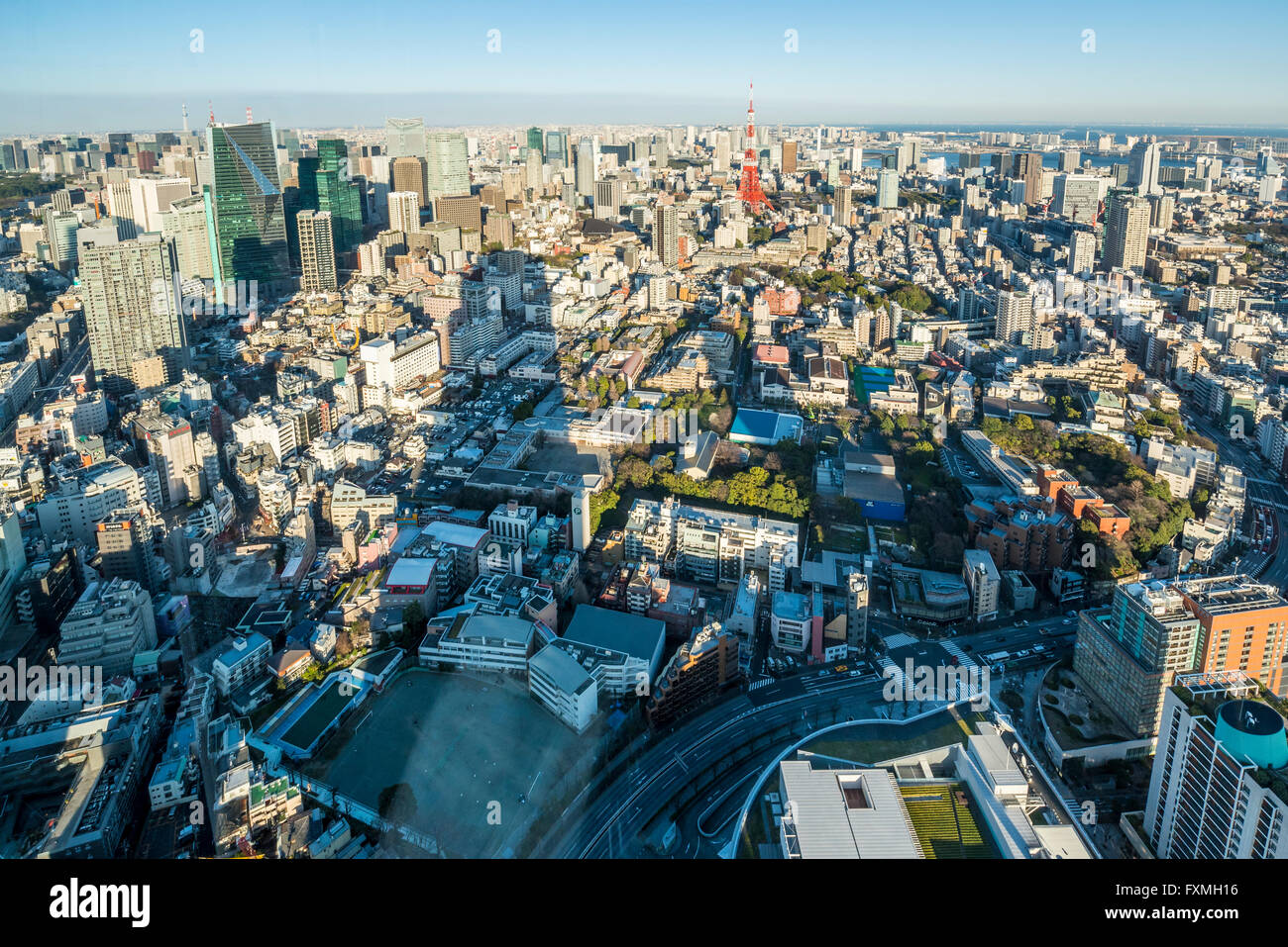 Tokyo tower and high rise buildings in Tokyo, Japan - Stock Image