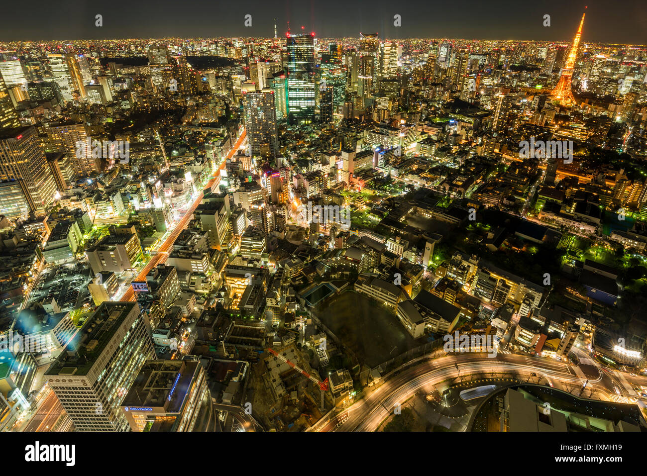 Tokyo tower and high rise buildings at night in Tokyo, Japan - Stock Image