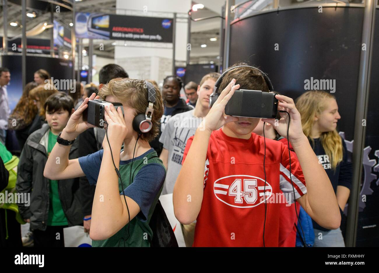 Children take a virtual tour of Mars using immersive VR goggles during Sneak Peek Friday at the USA Science and - Stock Image