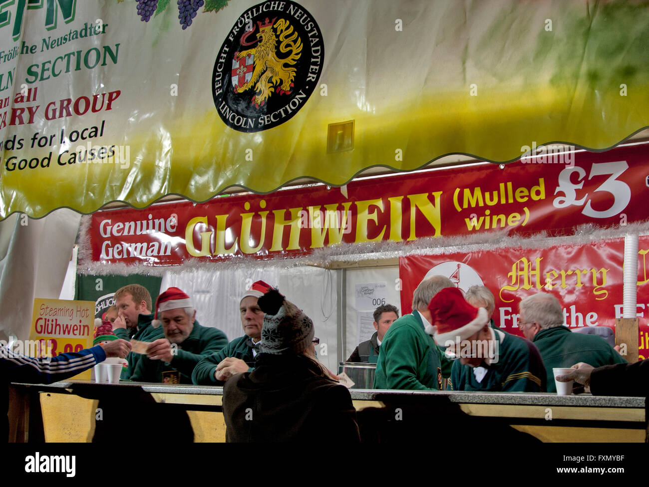Christmas market in Lincoln, Lincolnshire, England, a booth from Neustadt, Germany selling hot mulled wine. - Stock Image