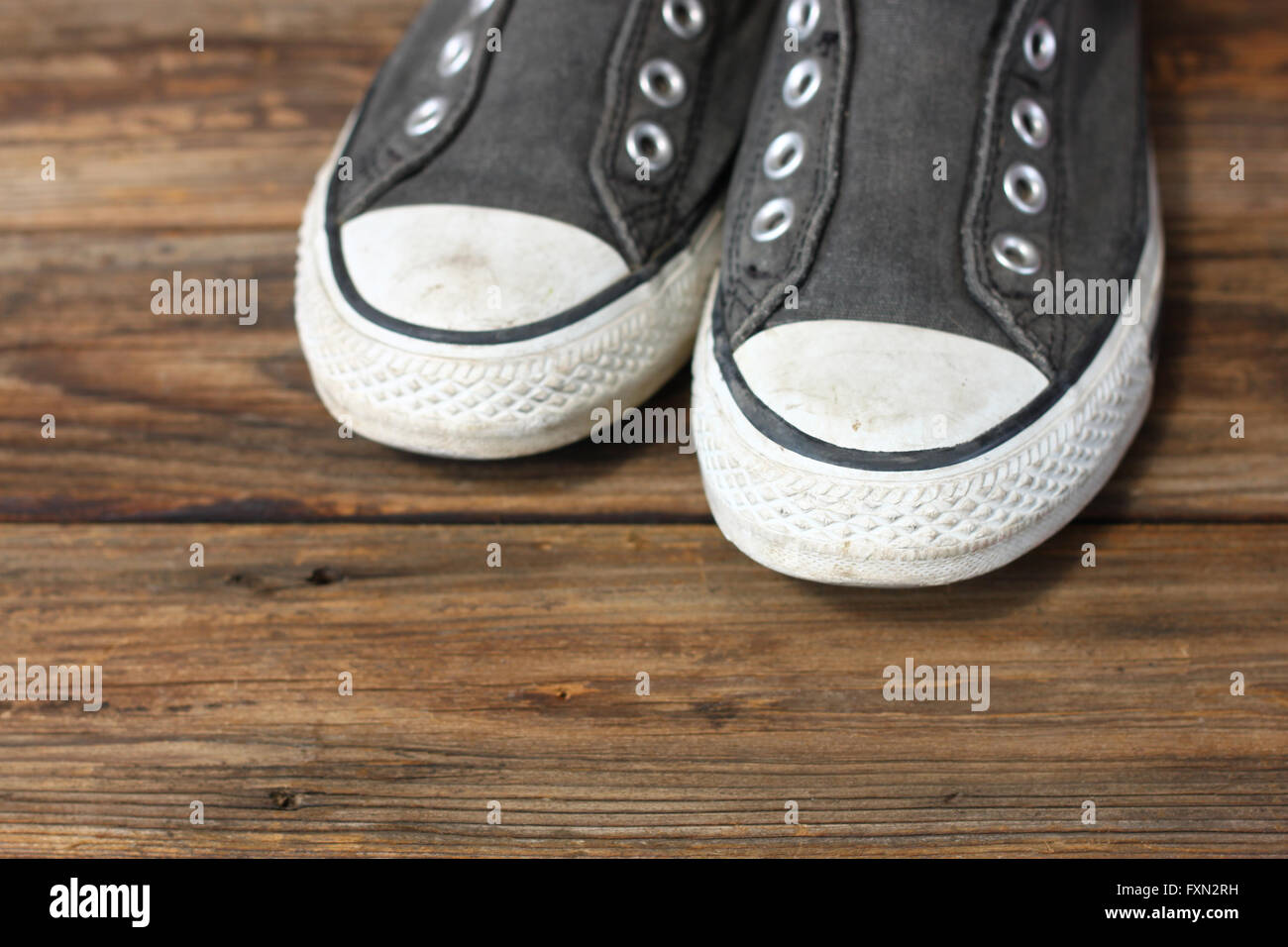 sneakers on wooden deck. - Stock Image