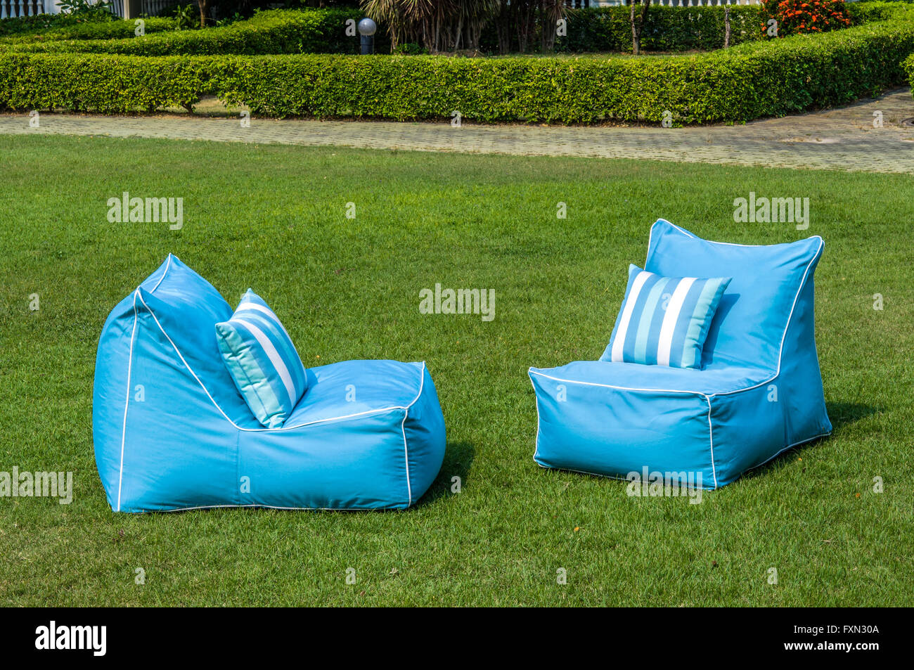Outdoor bean bags with water resistant pillows - Stock Image