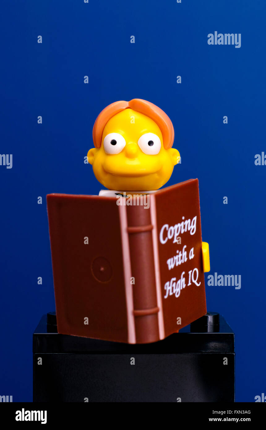 Tambov, Russian Federation - June 08, 2015 Lego Martin Prince (The Simpsons Movie) minifigure with book on blue - Stock Image