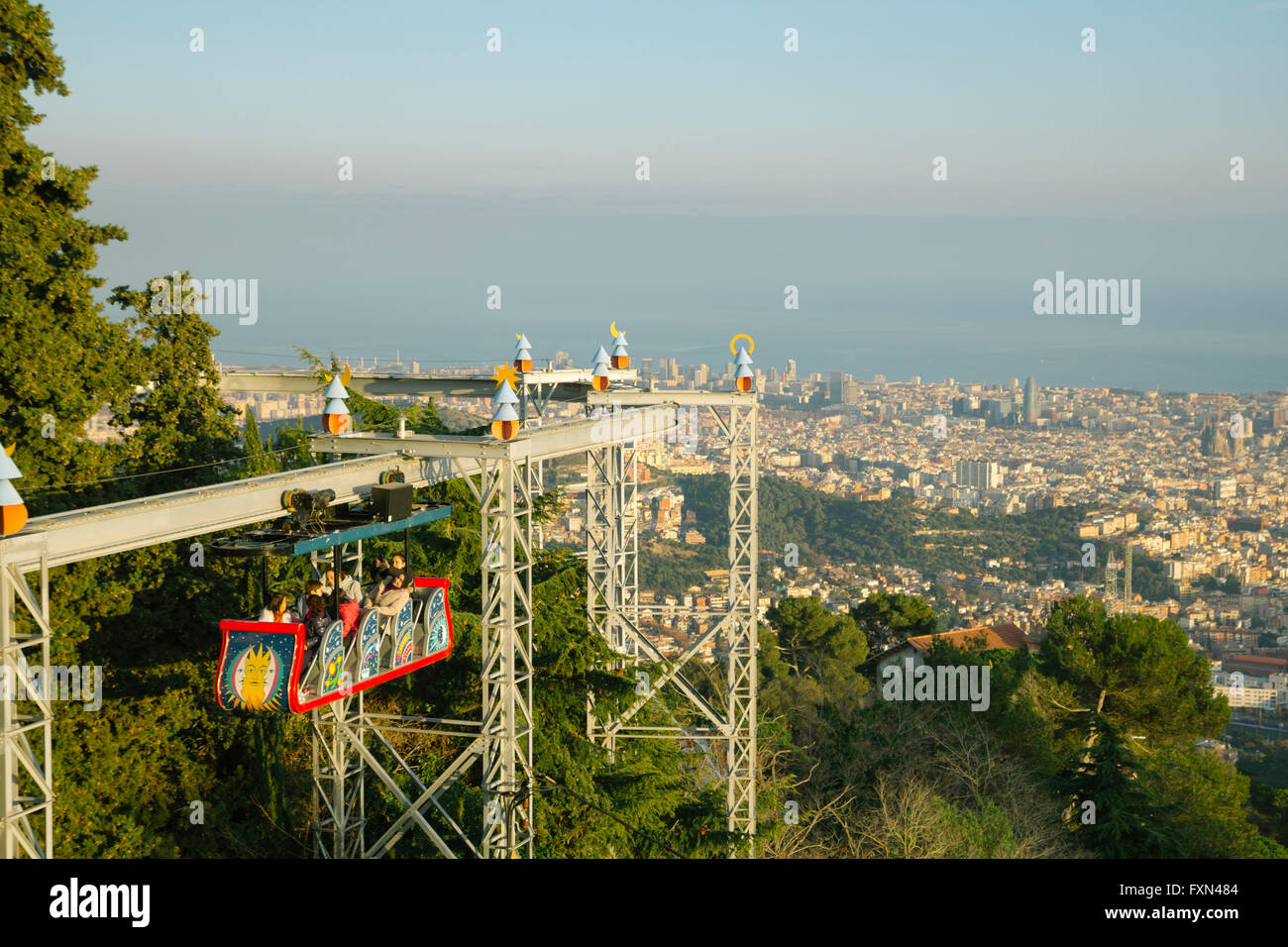 Tibidabo amusement park, with people having fun with the roller coaster in Barcelona - Stock Image