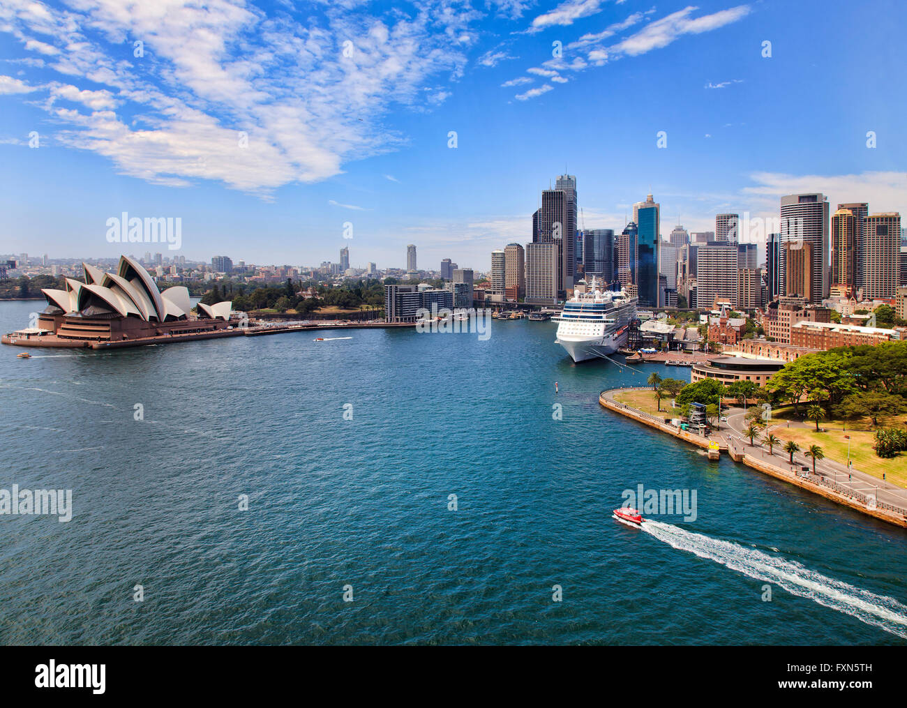 Aerial view from Sydney Harbour bridge lookout at Circular quay with ferries and overseas passenger terminal in - Stock Image