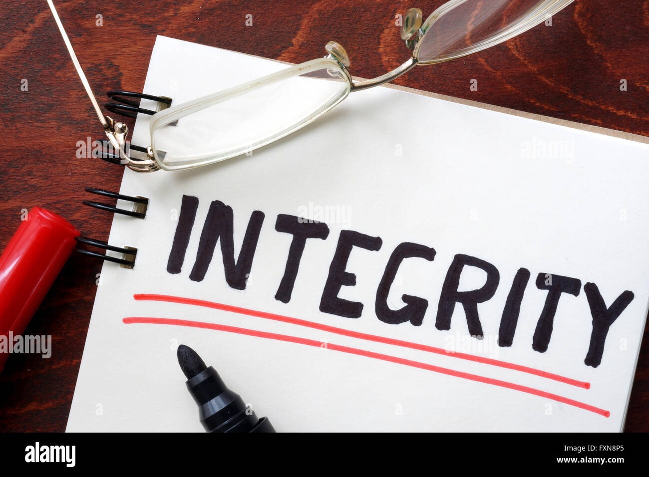 Integrity written in a notebook. Business concept. - Stock Image