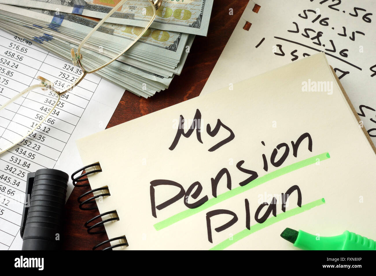 Pension plan written on a notepad. Savings concept. - Stock Image