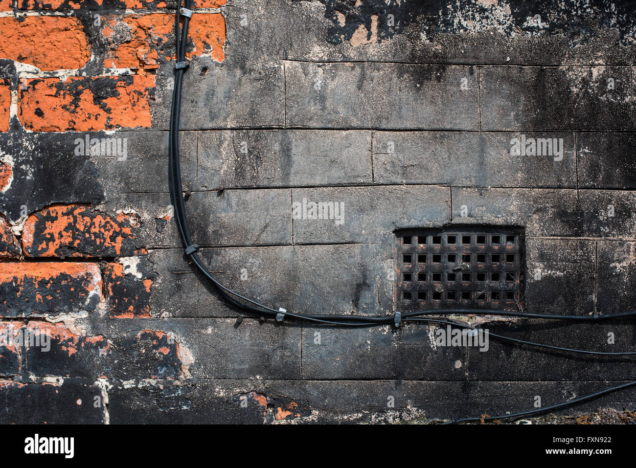 Black painted air vent and electric cables - Stock Image