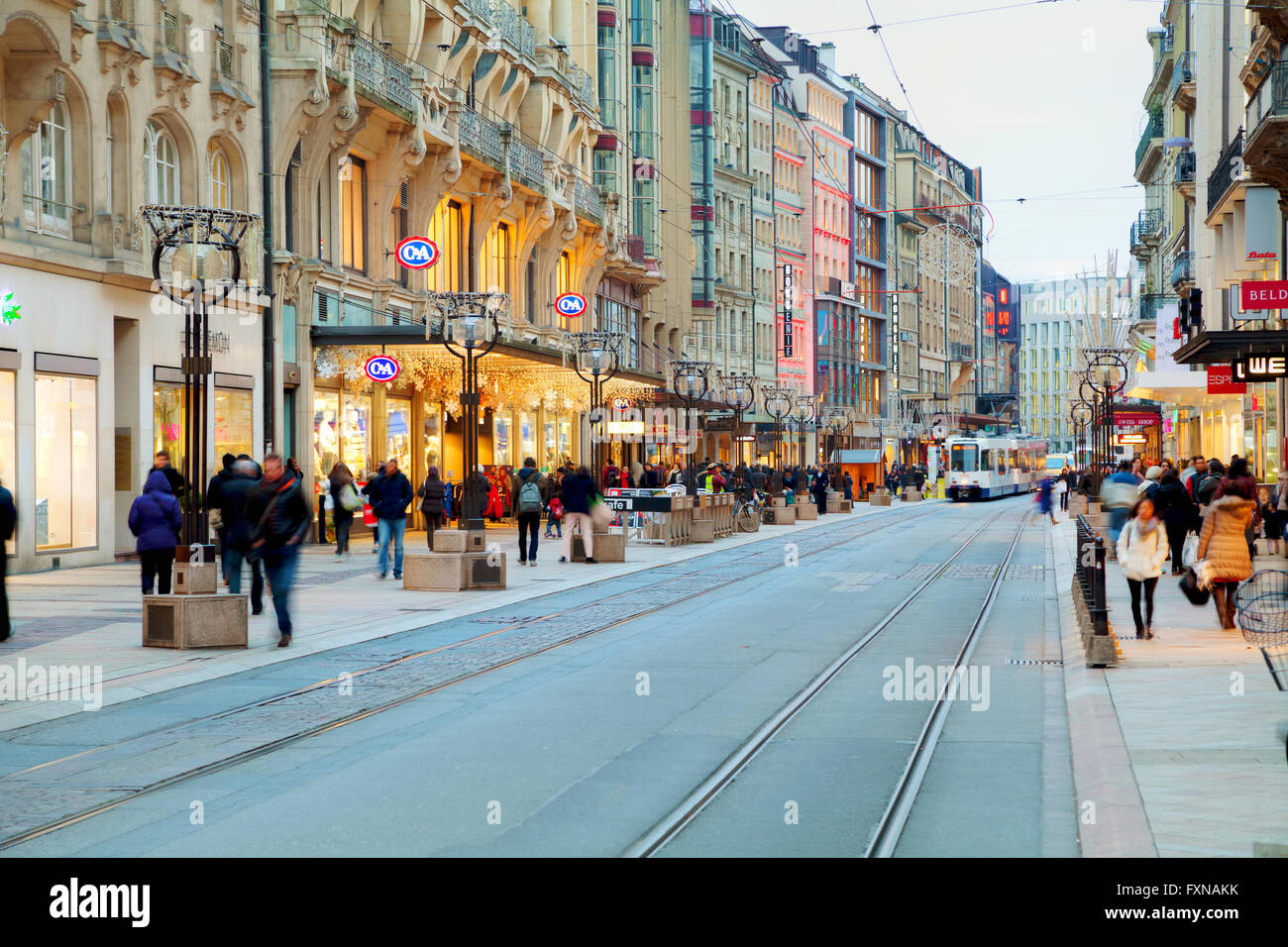 GENEVA, SWITZERLAND - NOVEMBER 27: Rue du Rhone with people on November 27, 2015 in Geneva, Switzerland. - Stock Image