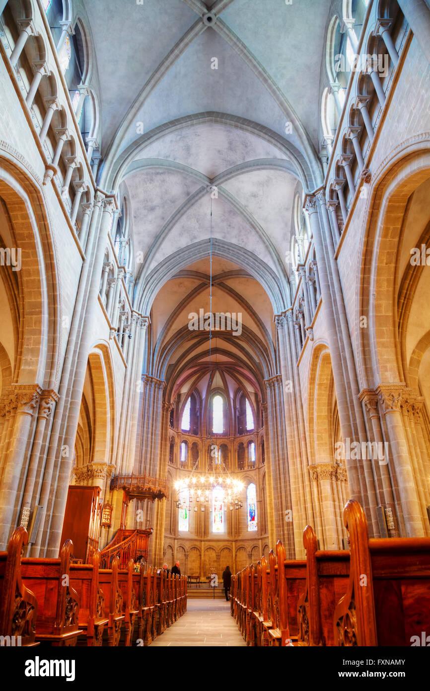 GENEVA, SWITZERLAND - NOVEMBER 28: St Pierre Cathedral interior with people on November 28, 2015 in Geneva, Switzerland. - Stock Image