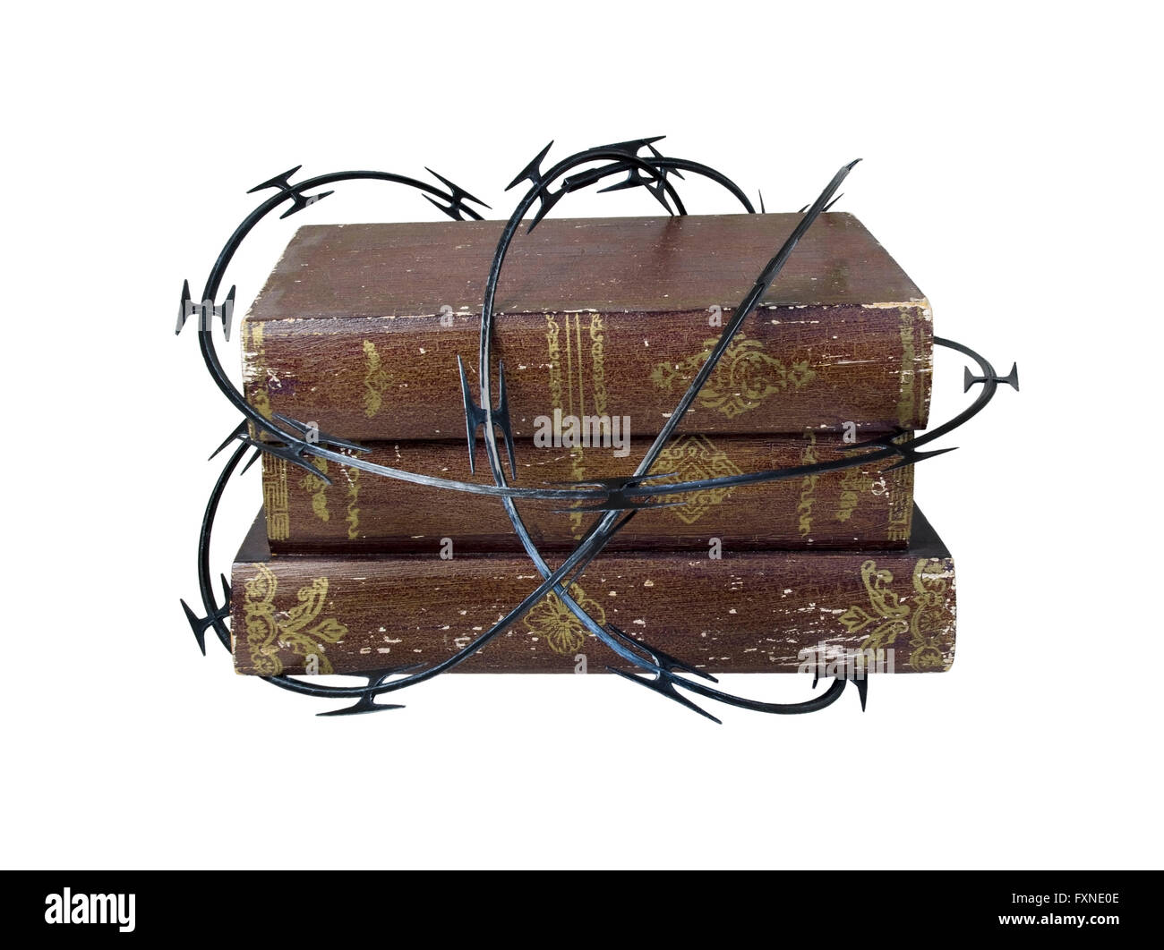 Sharp razor wired used as a barrier around old books Stock Photo