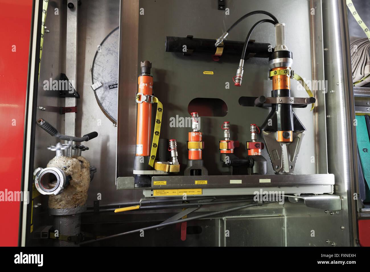 Saint-Petersburg, Russia - April 9, 2016: Firefighting equipment of modern Russian fire truck. Water hydrants - Stock Image