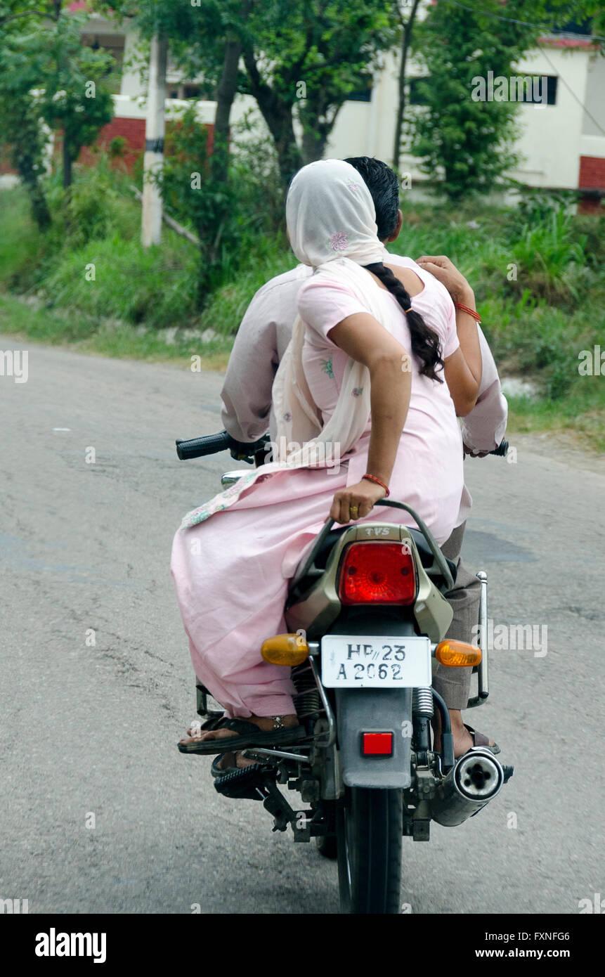 India couple bike stock photos india couple bike stock for Motor scooter store near me
