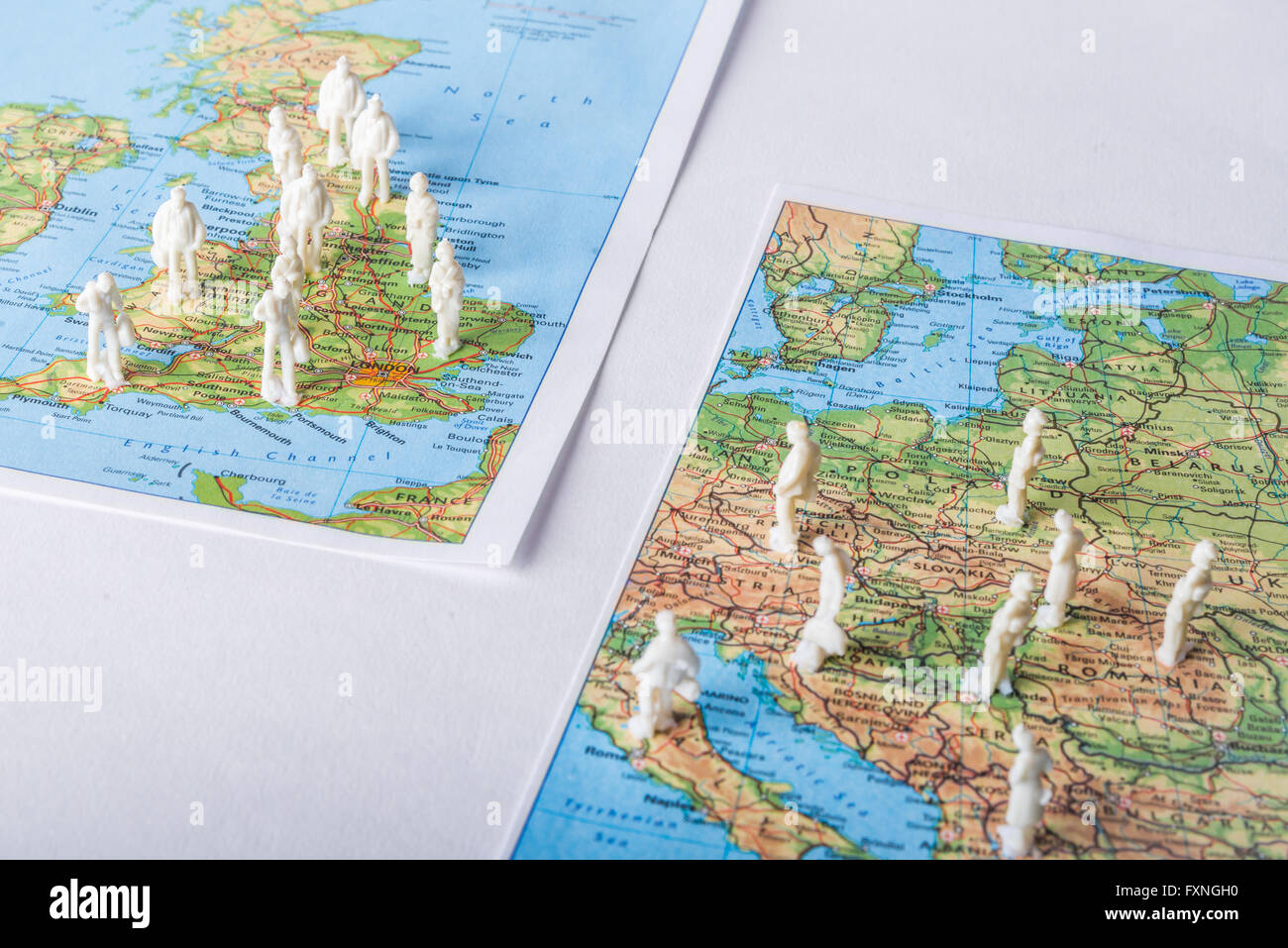 Figures of people standing on maps of UK and Europe, symbolizing making decision about Brexit - Stock Image