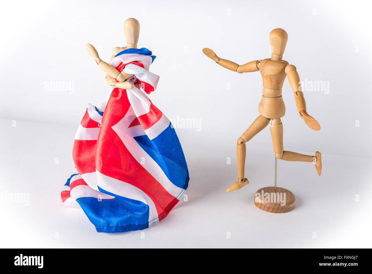 Wooden mannequins symbolizing UK leaving EU in Brexit Stock Photo