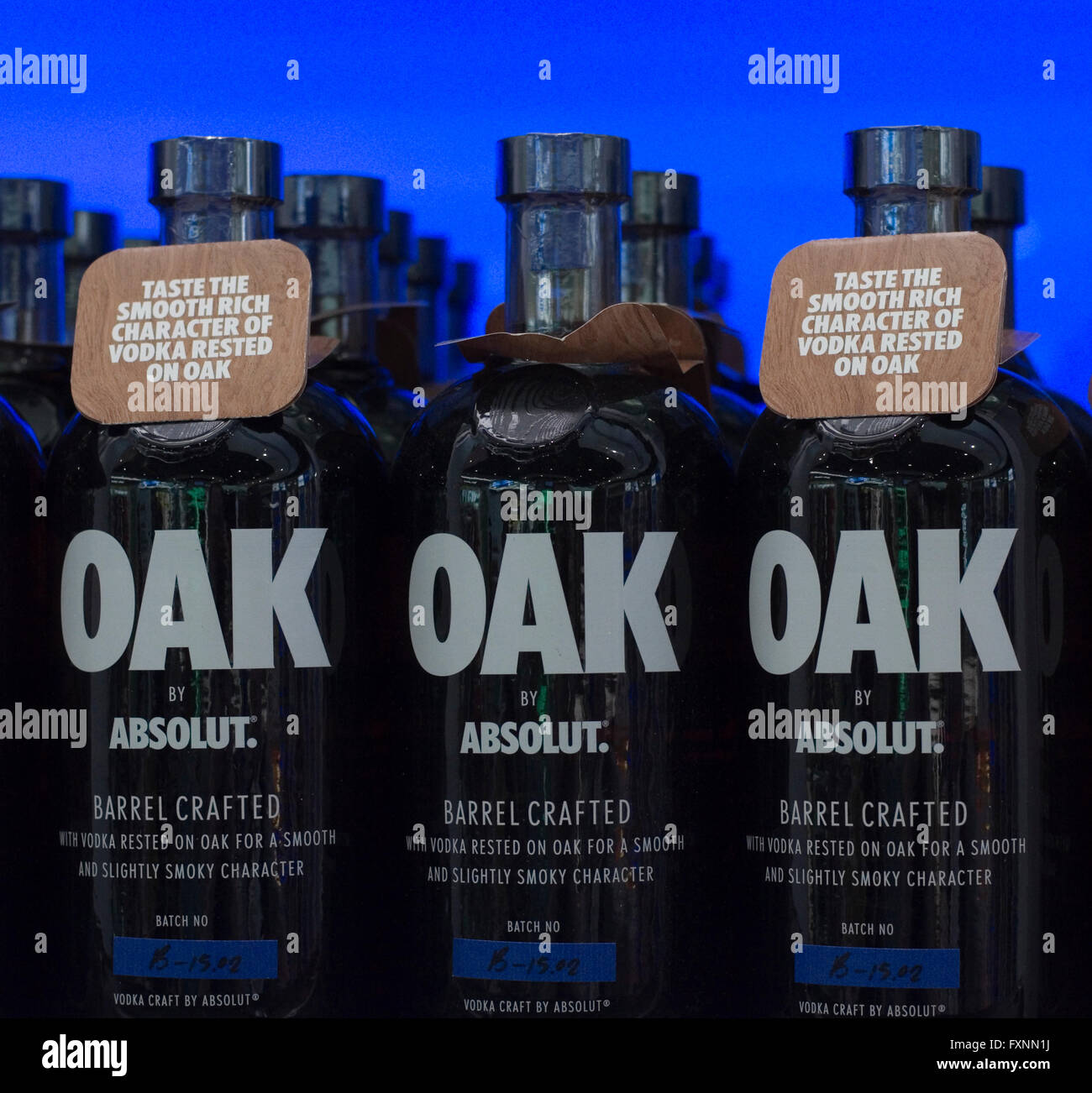 Absolut Vodka Oak.  Bottles on display against a blue illuminated background. Stock Photo