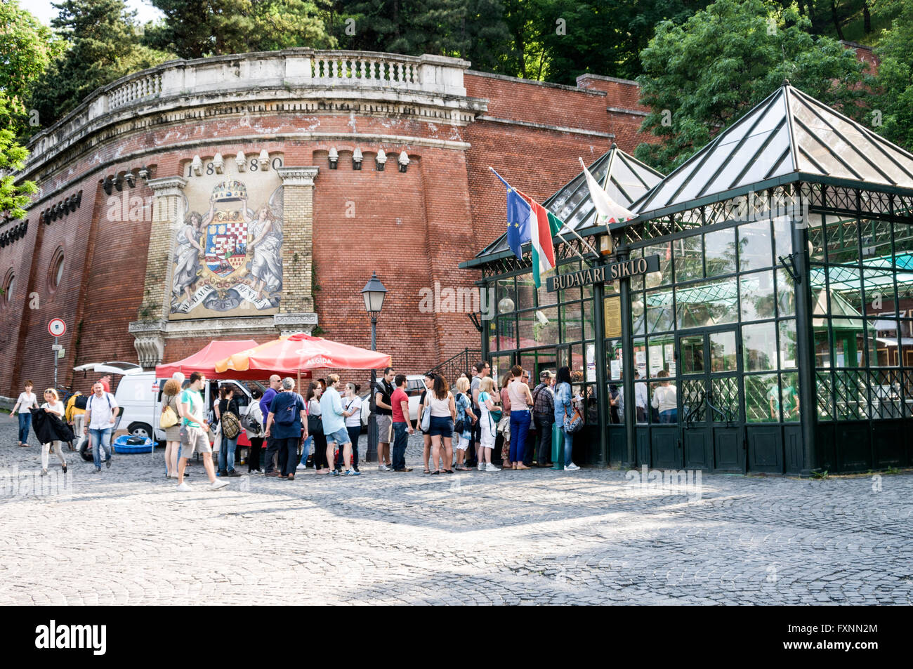 A line of tourists queue at the funicular terminal at the foot of Castle Hill on the Buda side of Budapest in Hungary. Stock Photo