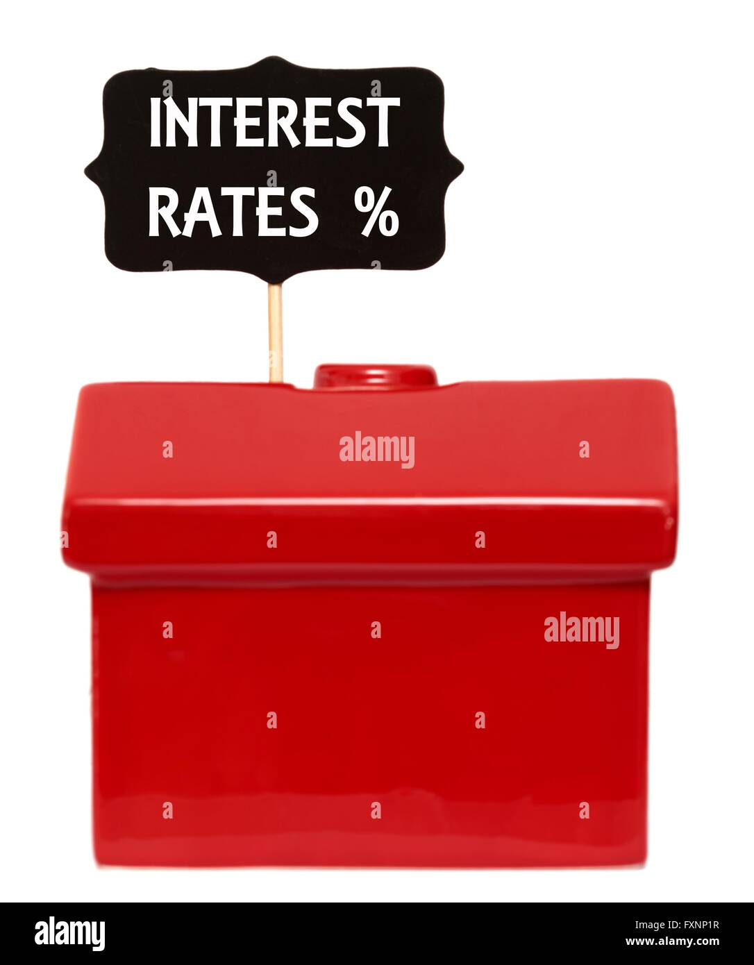 Red house with interest rates % sign - Stock Image