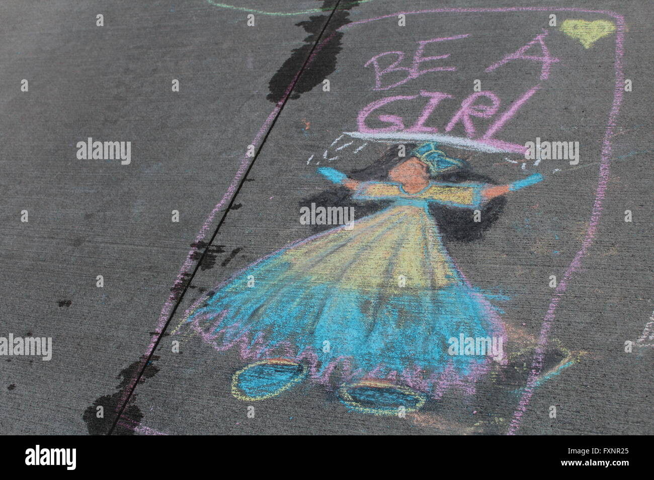 chalk drawing of girl on sidewalk - Stock Image