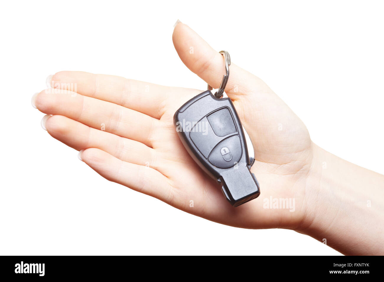 Female hand holding car keys in the palm - Stock Image
