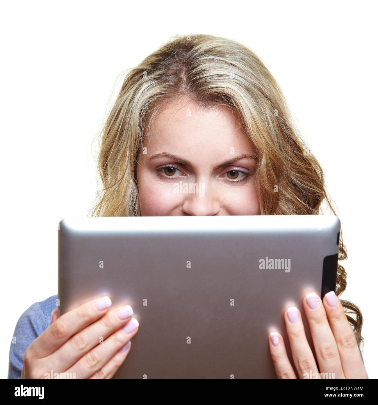 Blonde woman reading a digital book with an ebook reader - Stock Image