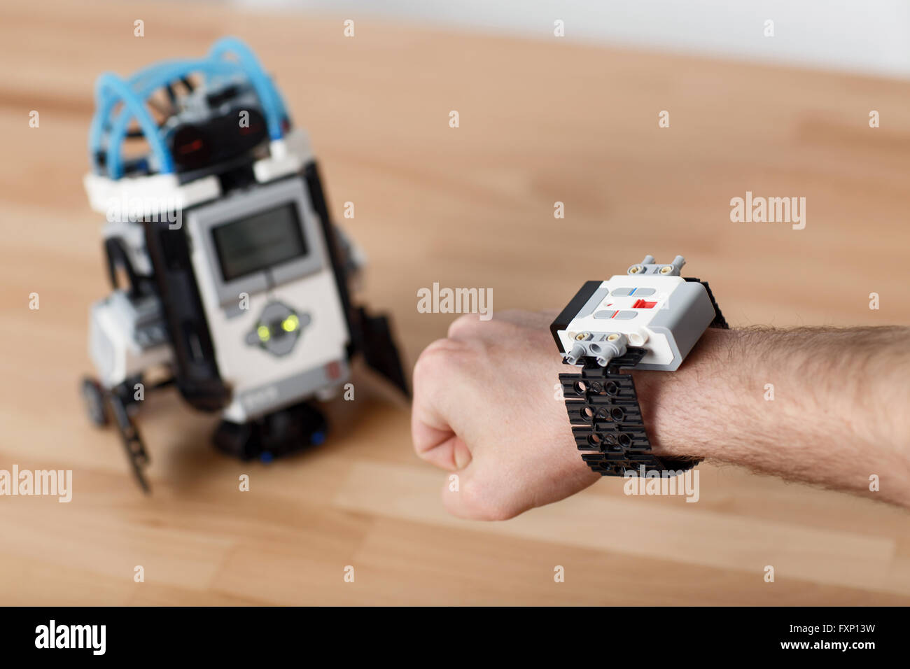 Pleasant man using robot - Stock Image