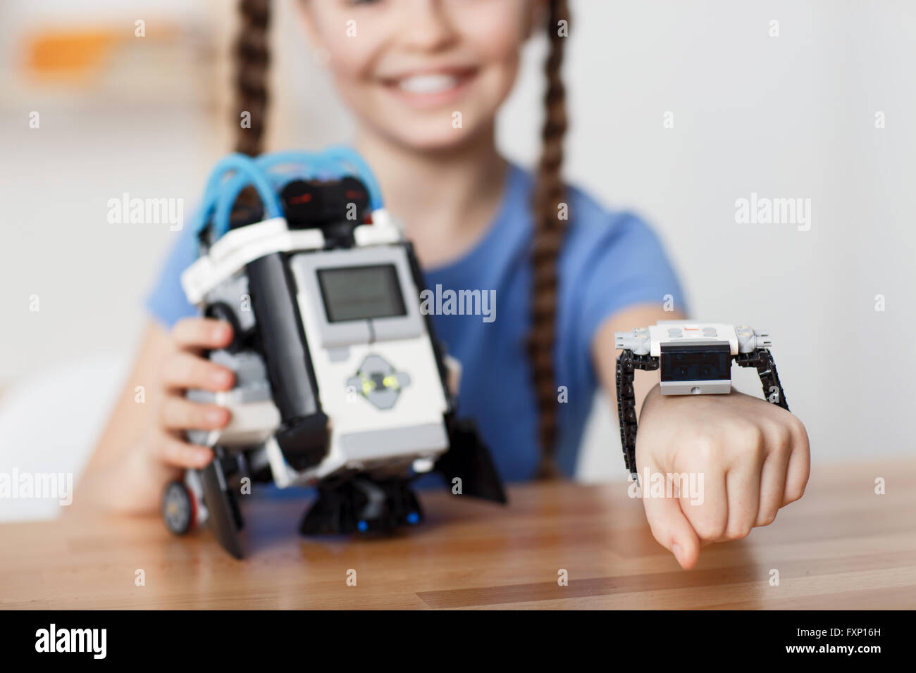 Nice girl playing with robot - Stock Image
