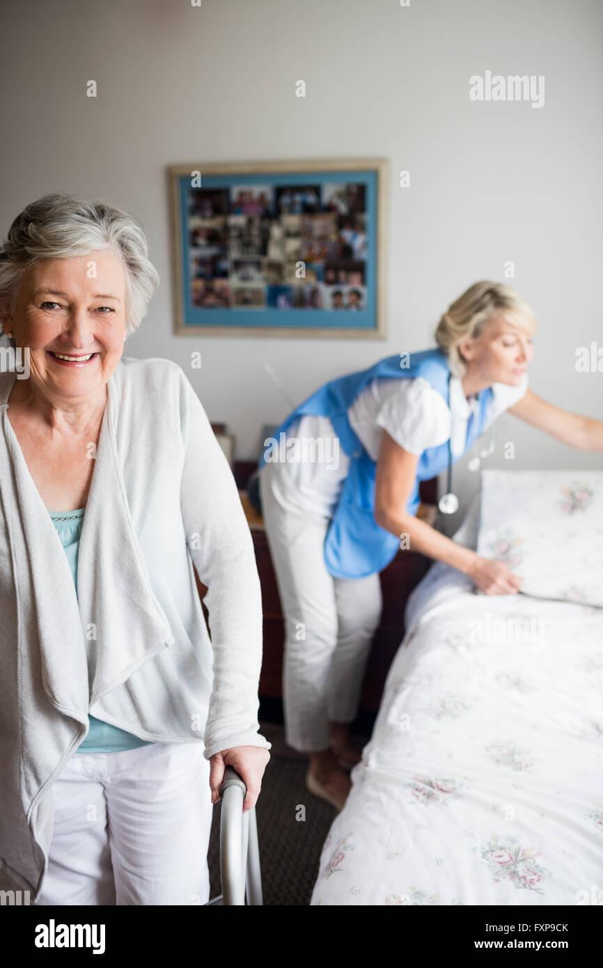 Nurse and senior woman are posing - Stock Image