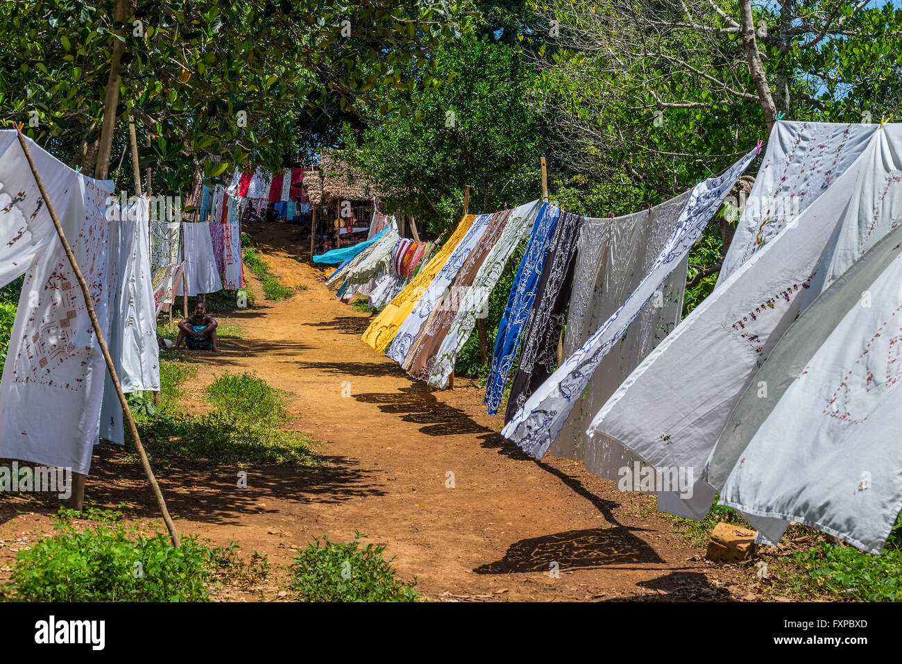 Selling embroidered tablecloths in the rural village of the Ampasipohy, Nosy Be - Stock Image