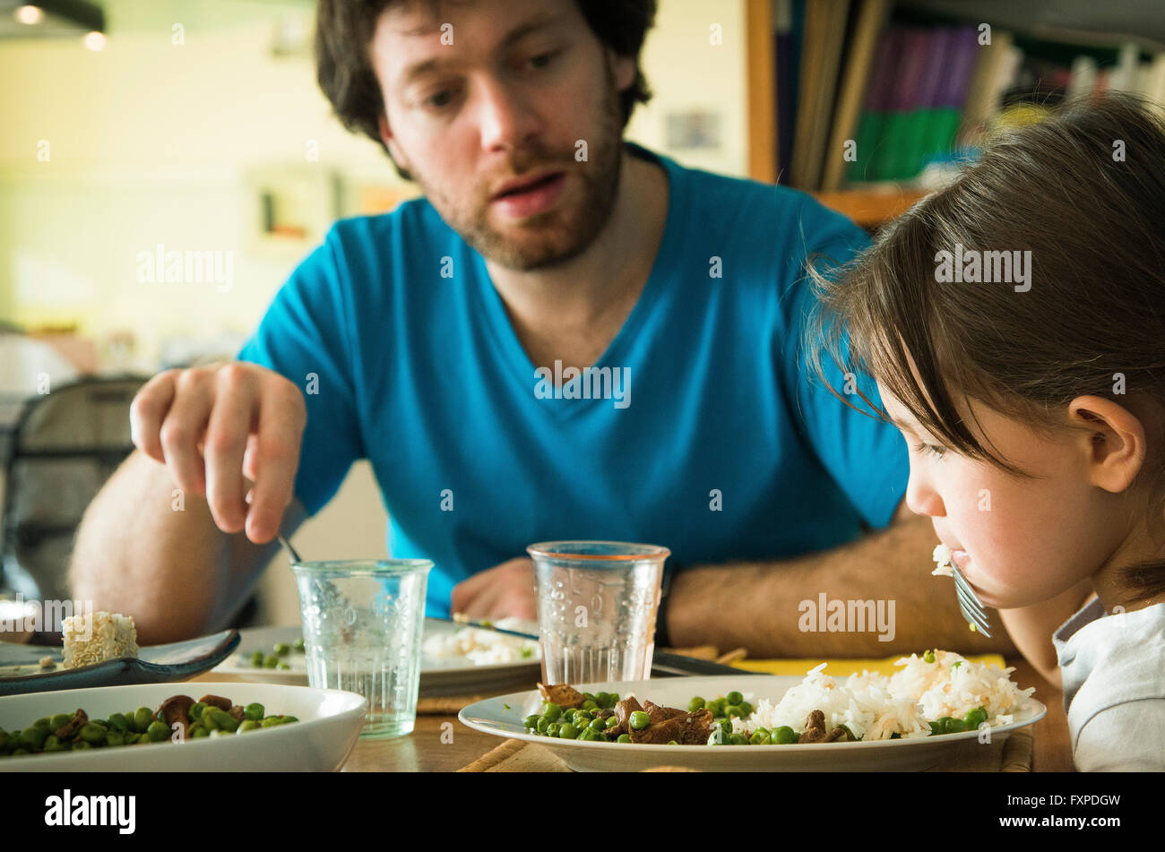Little girl refusing to eat her dinner - Stock Image