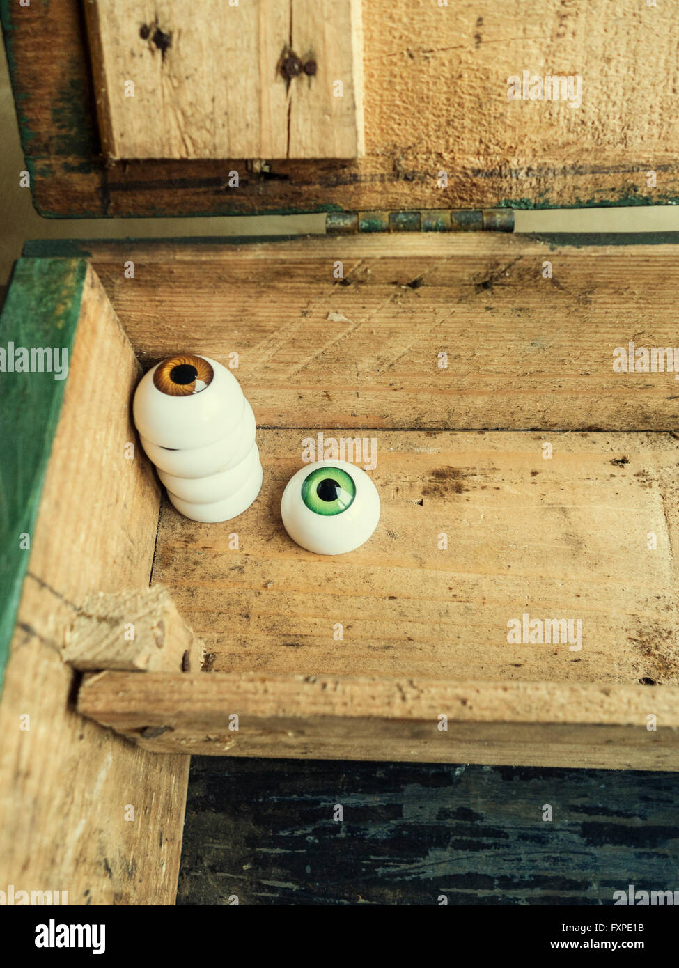 Plastic eyeballs in a wooden box - Stock Image