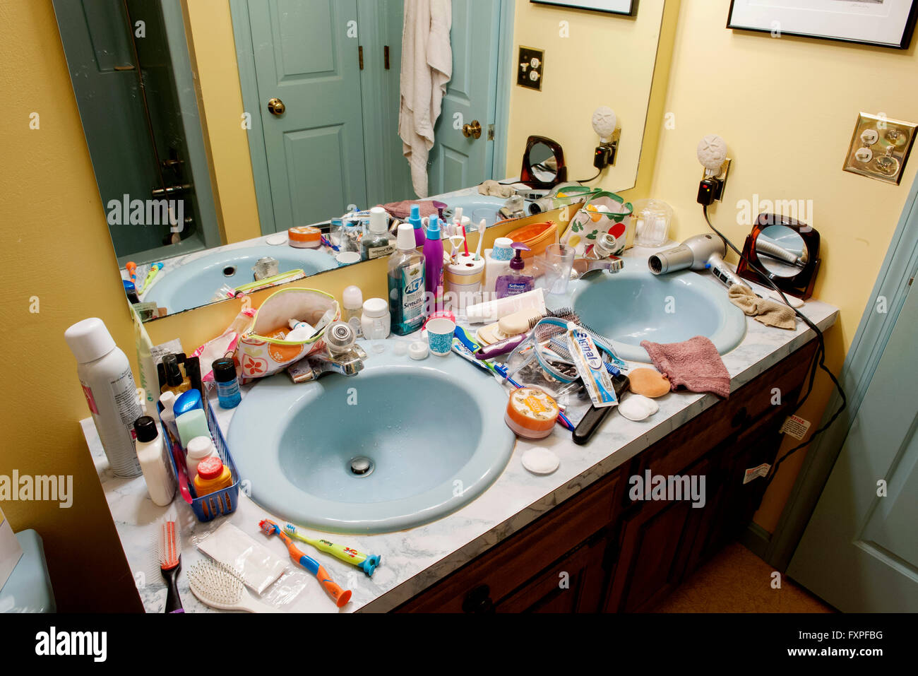 Bathroom Sinks Cluttered With Health And Beauty Products