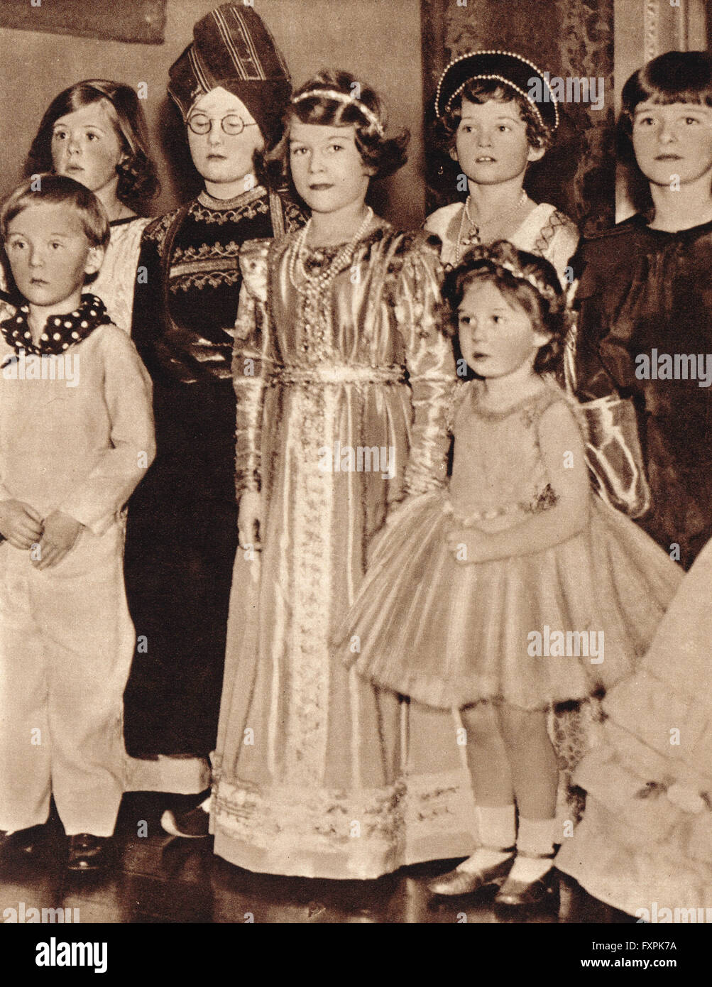 Princess Elizabeth, the future Queen Elizabeth II, at a fancy dress party with her sister Margaret in 1934 - Stock Image