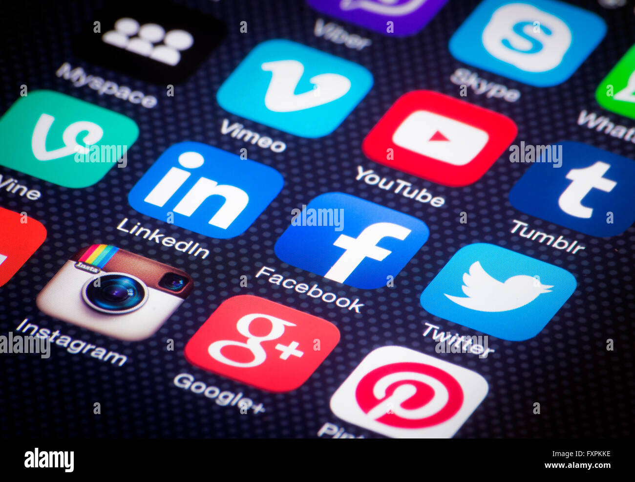 social media icons on smartphone screen - Stock Image