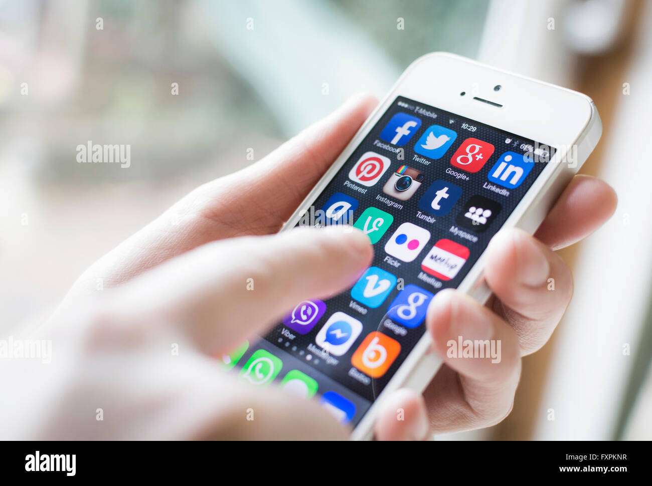 Social media on smartphone screen - Stock Image