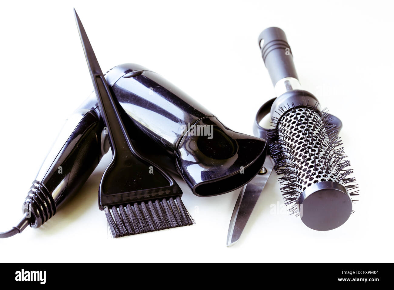 Tools for hairdresser (hair dryers,scissors,combs) - Stock Image