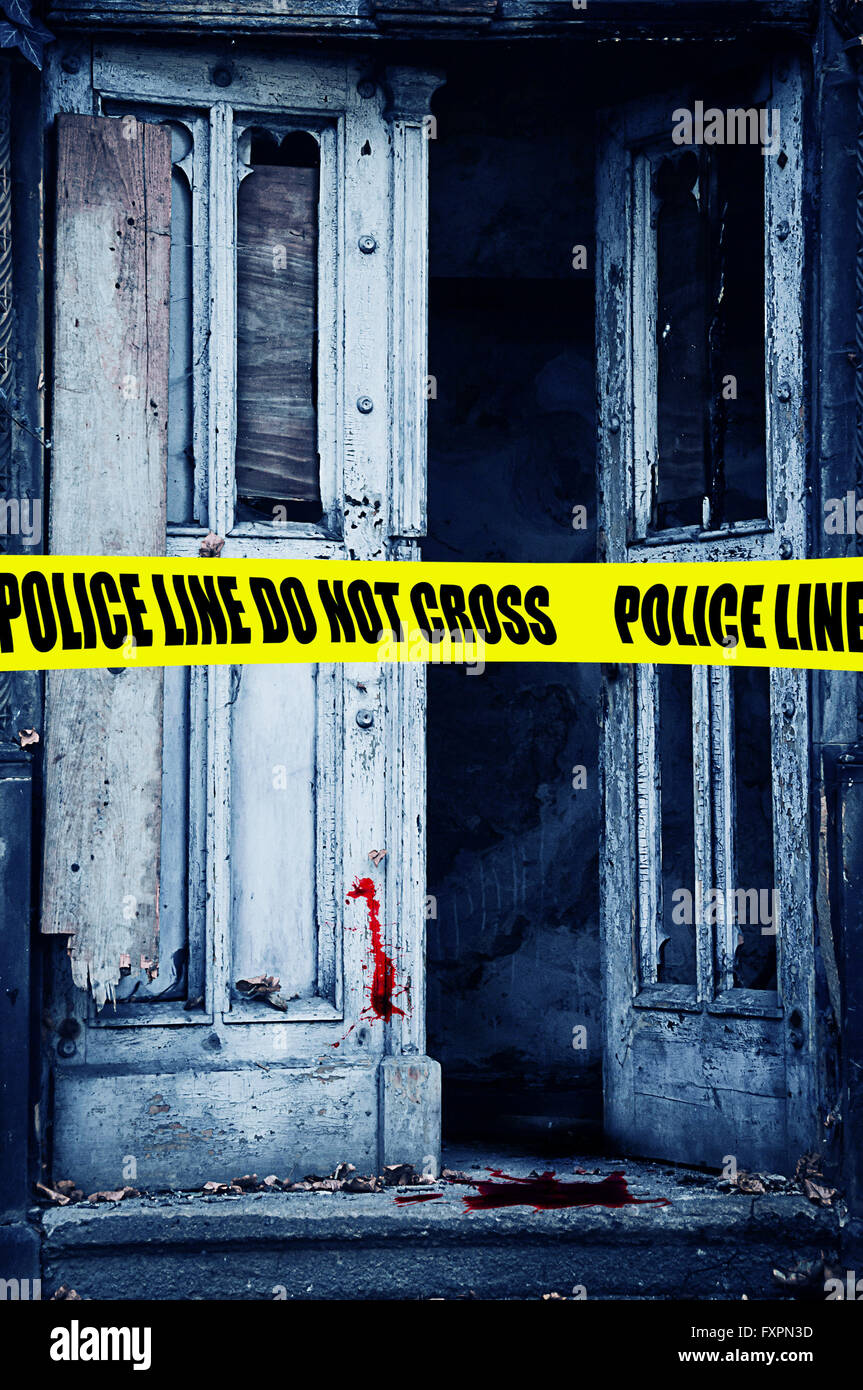 police tape and open door with blood, crime scene - Stock Image