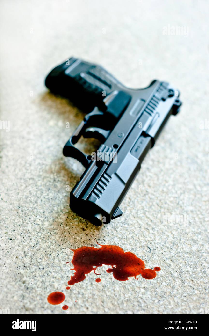 handgun lying on the floor with blood near it, image for book cover - Stock Image