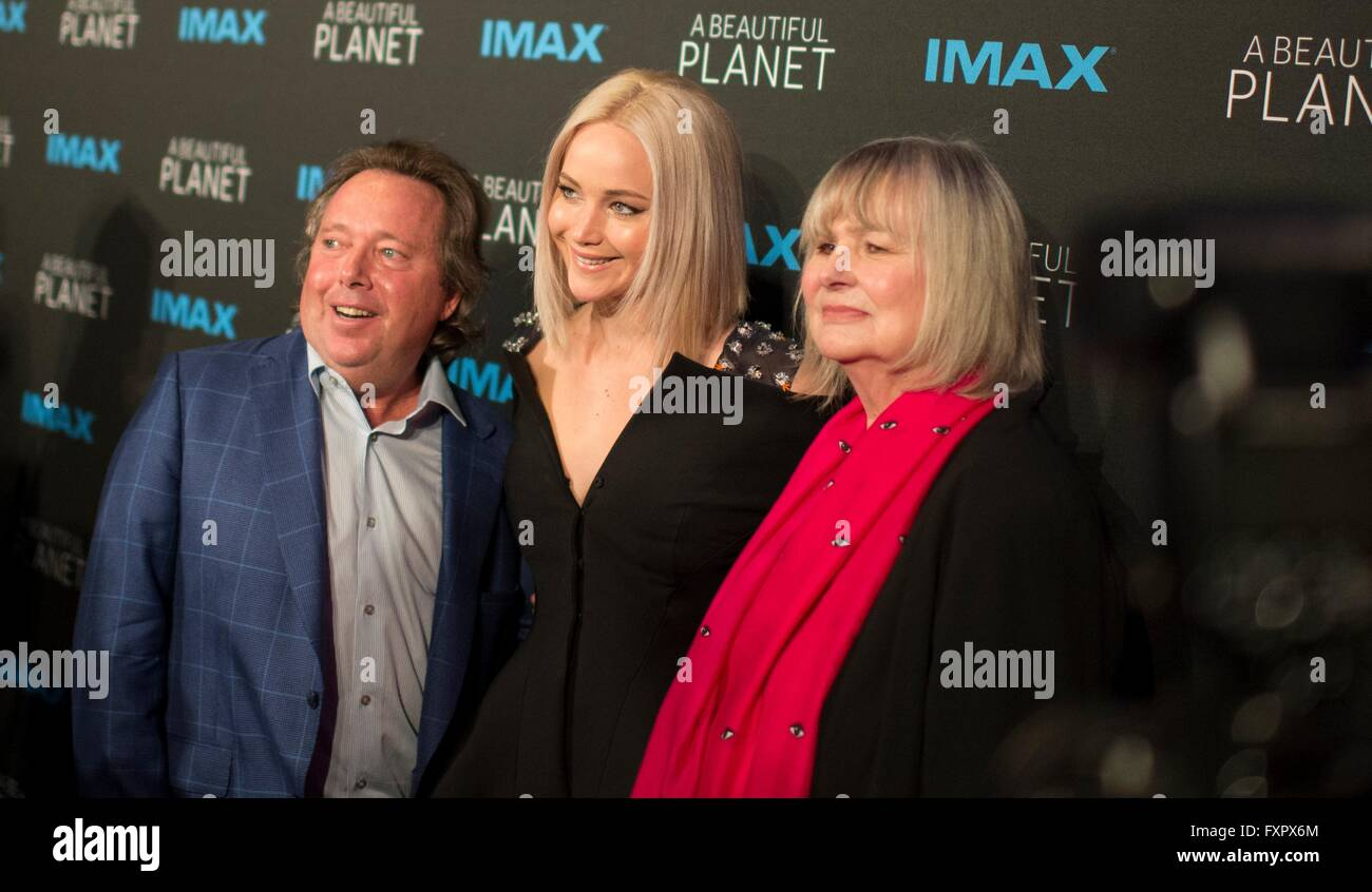New York, USA. 16th Apr, 2016. Actress Jennifer Lawrence poses for a photo with Richard Gelfond, CEO of IMAX, left, - Stock Image