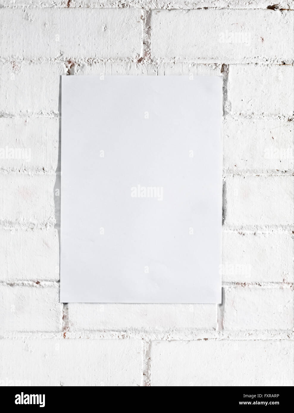 white brick wall with template poster (It serves as template) background - Stock Image