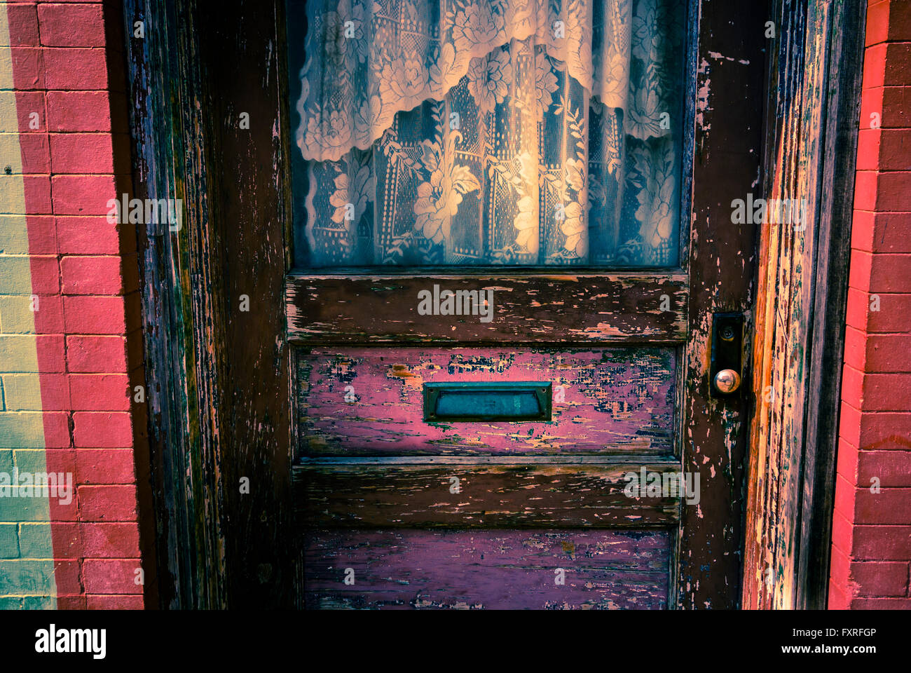 Old antique door way in downtown Manistee, Michigan, USA - Stock Image