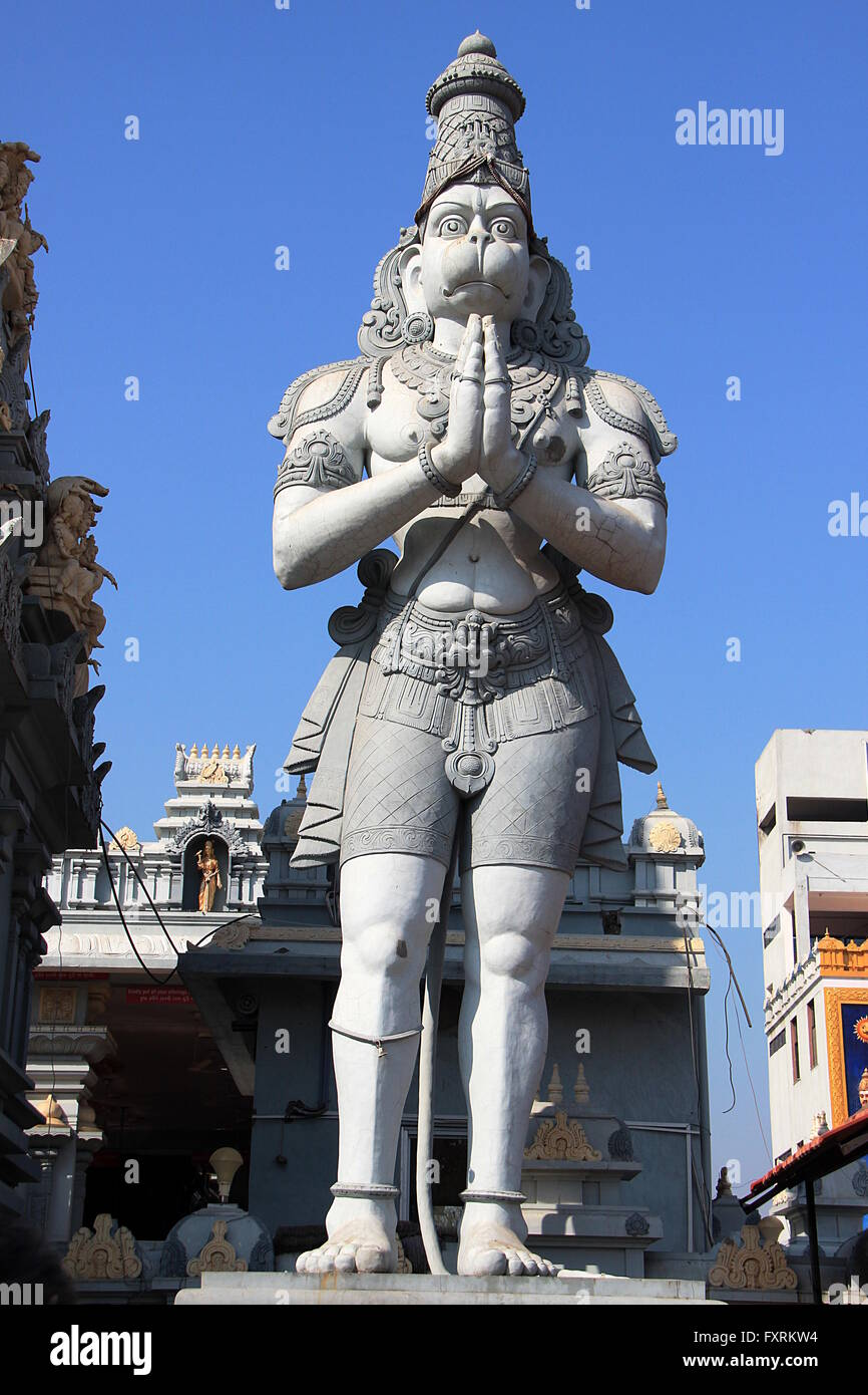 Cement statue of Anjaneya with folded hands in standing posture at Balaji Temple in Ahmedabad, Gujarath, India, - Stock Image