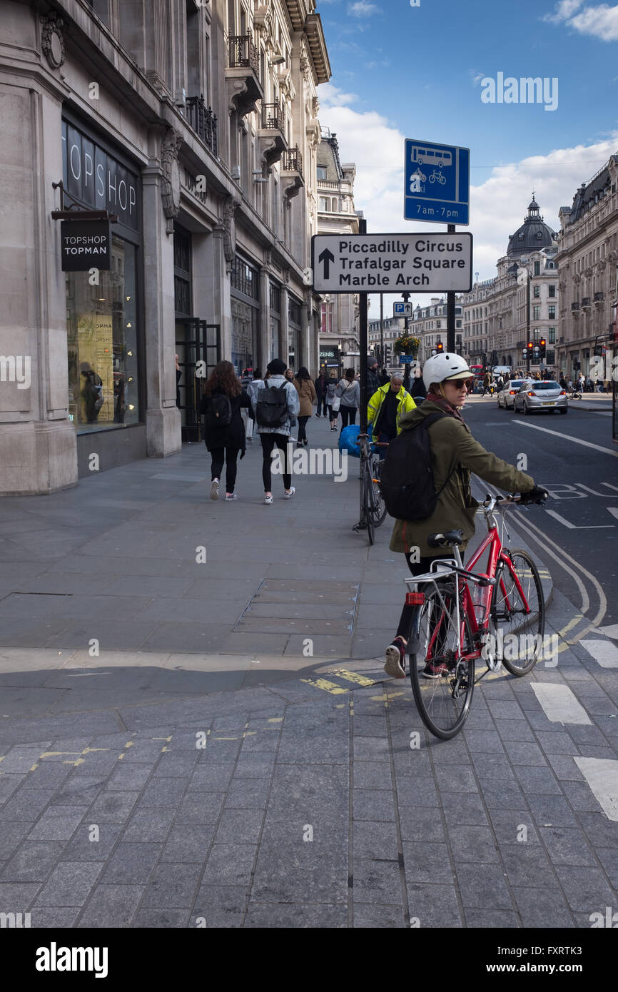 London streetscene with sign for Piccadilly Circus, Trafalgar Square & Marble Arch - Stock Image