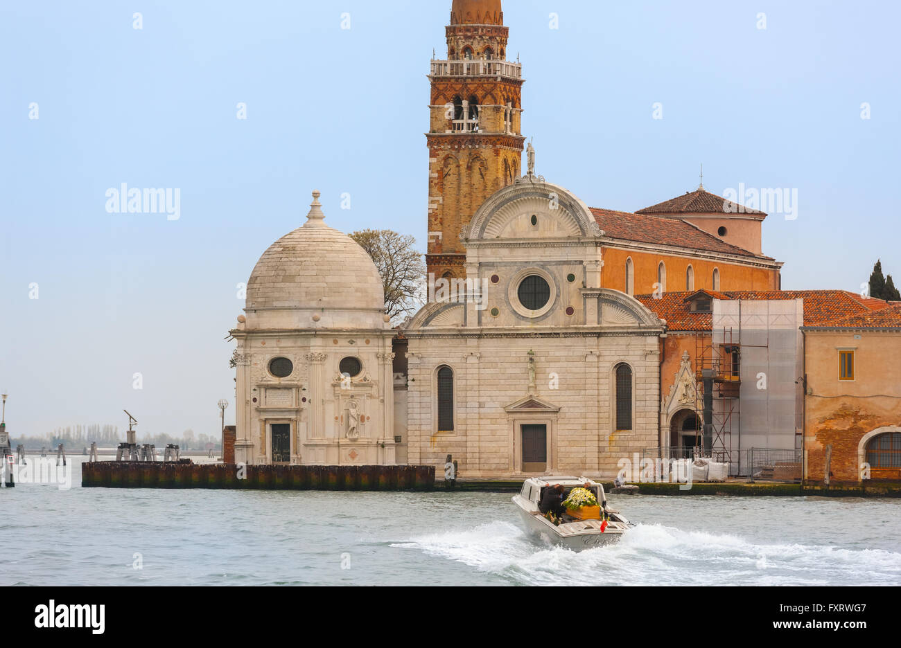 Venice, Italy, Chiesa di San Michele in Isola. Water hearse funeral boat on it's way to the cemetery on San - Stock Image