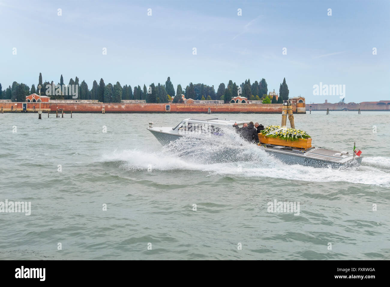 Venice, Italy. Water hearse or funerary, funeral boat on it's way to Venice's cemetery on Isola di San Michele - Stock Image