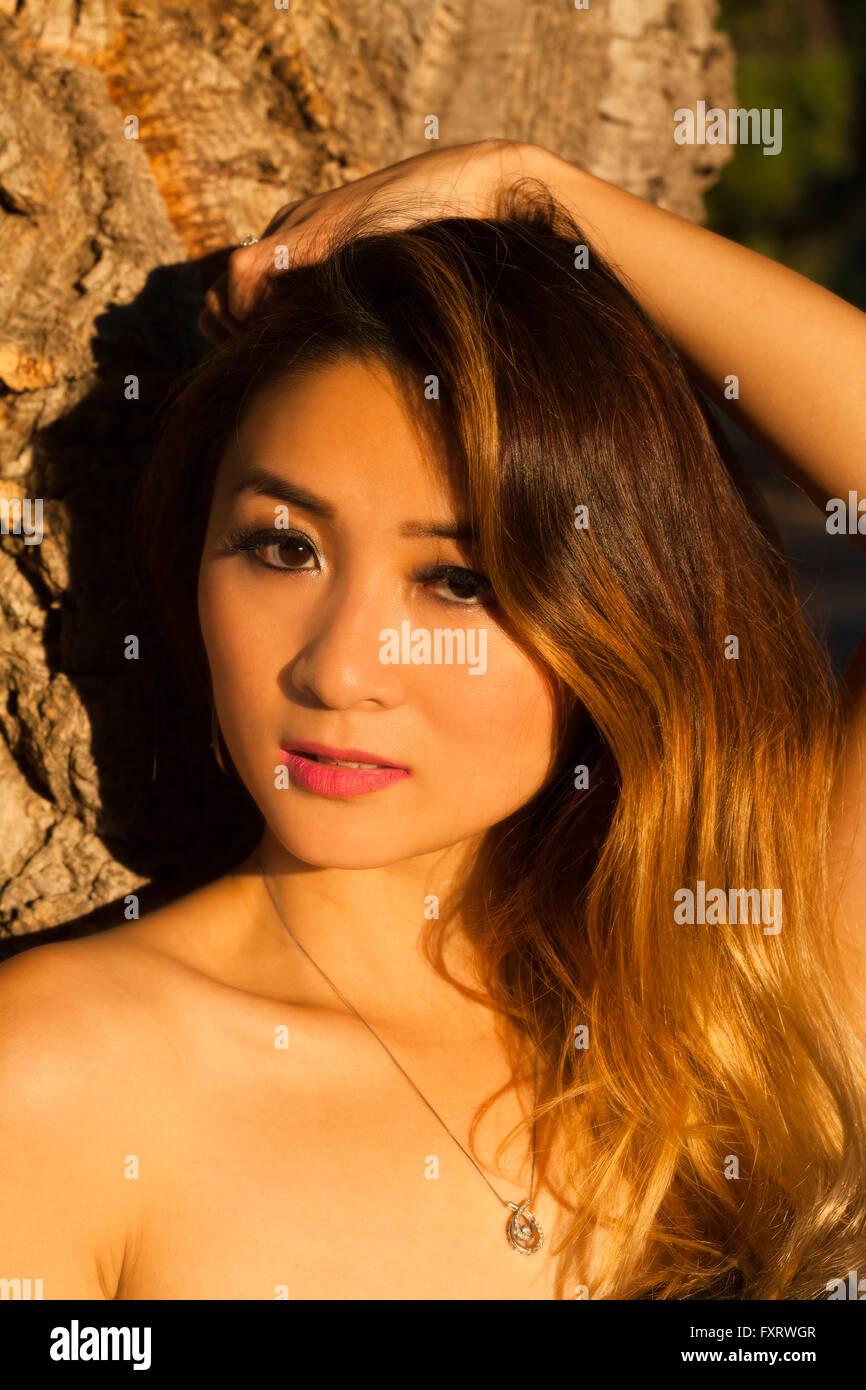 Oriental Woman Outdoors Portrait Bare Shoulders Attractive - Stock Image