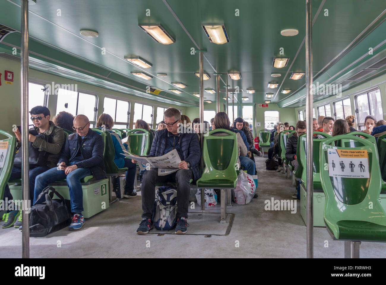 Venice Vaporetto to Murano, Burano and Torcello. Commuters and tourists on the Venice Lagoon water bus. - Stock Image